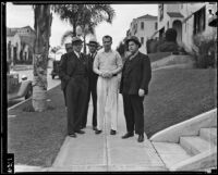 Assailant William Hardy surrounded by detectives, retracing the crime scene, Los Angeles, 1935