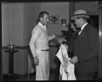 Assailant William Hardy in handcuffs with detective Joe Filkas, Los Angeles, 1935