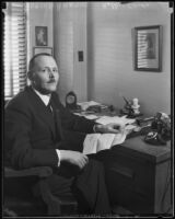 Dutch consul Adrian Hartog seated in his office, Los Angeles, 1930