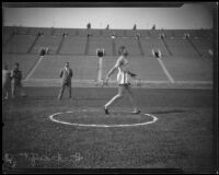 "Glenn ""Tiny"" Hartranft participating in the discus throw at the Coliseum, Los Angeles, 1922-1927"