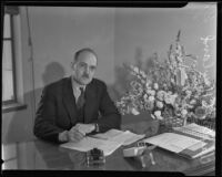Sales tax administrator Clayton L. Howland at his desk, Los Angeles, 1935