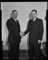 Judges Clarence L. Kincaid and Frank M. Smith shaking hands, Los Angeles, 1933-1939