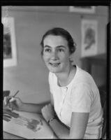 Dorothy Jeakins, Otis Art Institute award winner, with a fashion illustration, Los Angeles, 1934