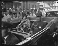 Prince and Princess Kaya of Japan in an automobile greeted by a crowd, Los Angeles, 1934