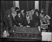 La Crescenta Woman's Club with Supervisor Jessup, going over maps of their community, Los Angeles, 1934