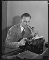 Portrait of author and director Emory Johnson at his typewriter, Los Angeles, 1940