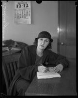 Leontine Johnson signing court papers, Los Angeles, 1928-1932