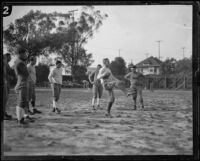 USC head football coach Howard Jones demonstrating at a practice, Los Angeles, 1925-1939