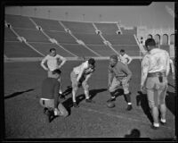 Coach Howard Jones instructing his team at the Los Angeles Memorial Coliseum. Los Angeles, 1925-1939