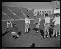 Coach Howard Jones instructing his team at the Coliseum, Los Angeles, 1925-1939