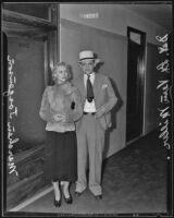 Actress Marchen Jorgensen with a detective after her arrest, Los Angeles, 1935