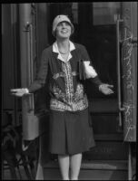 Actress Leatrice Joy in front of a train car, 1931