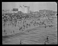 Crowd celebrating the Fourth of July holiday on a beach, Santa Monica, 1929