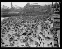 Crowd celebrating the Fourth of July on Venice Beach beach near Lick Pier and Ocean Park Pier, Venice, 1929