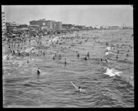 Crowd celebrating the Fouth of July on Ocean Park Beach, Santa Monica, 1929
