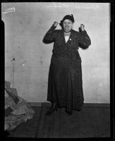 Congresswoman Florence Kahn raising her fists, 1928