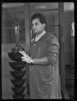 Atanas Katchmakoff, sculptor, with his bronze Madonna sculpture, Los Angeles, 1935