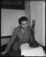 Atanas Katchmakoff, sculptor, with his bronze Madonna sculpture, Los Angeles, 1935