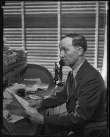 William Kerr, Los Angeles County Registrar of Voters at his desk, Los Angeles, 1924-1939