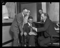 Detectives surround John D. Wiley and his wife as they confess to insurance fraud, Los Angeles, 1924