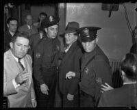 Eugene Kent, President of Glendale Protective Association, led by police, Glendale, 1935