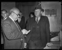 Eugene Kent, President of Glendale Protective Association, speaking with a reporter, Glendale, 1935