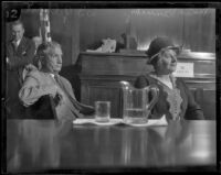Minnie Kennedy, mother of Aimee Semple McPherson, in court with her attorney W. I. Gilbert, Los Angeles, 1926