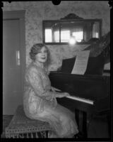 Minnie Kennedy, mother of Aimee Semple McPherson, playing a piano, Los Angeles, 1920-1939