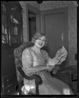 Minnie Kennedy, mother of Aimee Semple McPherson, with documents in her hands, Los Angeles, 1920-1939