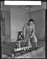 California Institute of Technololgy professor Arthur L. Klein demonstrating a balance scale, Pasadena, 1932