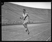 High school track athlete Vic Klein running at the Memorial Coliseum, Los Angeles, 1924-1926