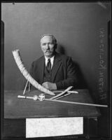 Anton Kolinowski with several ivory souvenirs from Africa, Los Angeles, 1932