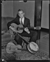 Musician James Korb with several of his instruments, Los Angeles, 1933