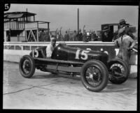 Pete Kreis seated in his race car at a speed way, 1925-1934