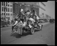 Native Americans ride in a truck down North Spring Street on Labor Day, Los Angeles, 1933