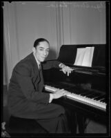 Agustín Lara, Mexican lyricist, singer and actor, seated at a piano, 1930-1939
