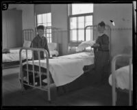 Two boys making a bed at the Lark Ellen Home for Boys, Sawtelle (Los Angeles), 1924
