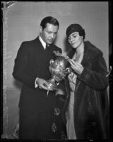 Ivan Lebedeff and Norma Boleslavsky with an artifact from the collection of Dr. Armond Hammer, on exhibit at Bullock's Wilshire, Los Angeles, 1932