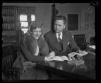Judge Joseph P. Sproul with actress Laura Lee signing her contract, Los Angeles, 1930
