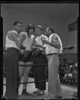 King Levinsky in the ring surrounded by Sam Levinsky, Harold Steinman, and Jerry Luvadis, Los Angeles, 1934