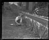 Dickie Brandon gardening, Los Angeles, 1926