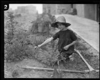 Muriel MacCormac kneels in the garden, Los Angeles, 1926