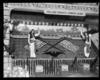 Two women stand in front of the College Heights Lemon Association booth at the Los Angeles County Fair, Pomona, 1929