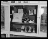 Cabinet of objects on display at the Los Angeles County Fair, Pomona, 1929
