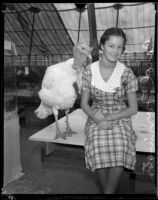 Carol Farrington and a turkey at the Los Angeles County Fair, Pomona, 1933