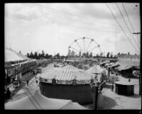 Amusement rides stand in a midway at the Los Angeles County Fair, Pomona, 1930