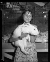 Forrest Mae Allison posing with her New Zealand rabbit at the LA County Fair, Pomona, 1934