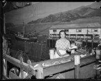 Katherine Butler working the California State Division of Fish and Game exhibit at the LA County Fair, Pomona, 1934
