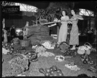 Dorothy Marshall and Manette Green at the LA County Fair with a replica of the first wine press in Escondido Valley, Pomona, 1934