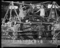 Patty Clark and Dorothy Marshal with an old-time water lift, Pomona, 1934